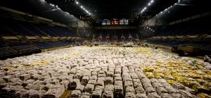 Fargo,ND, March 29, 2009--Volunteers from the Red River Valley and beyond work to fill sandbags in the Fargodome in preparation of upcoming storm.  Over 300,000 sandbags were stockpiled on this day. Andrea Booher/FEMA